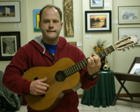Mark Hull plays guitar at exhibit